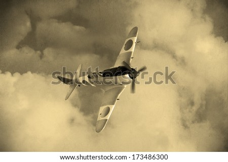 'Vintage style'  World War 2 Japanese fighter plane in the clouds - stock photo