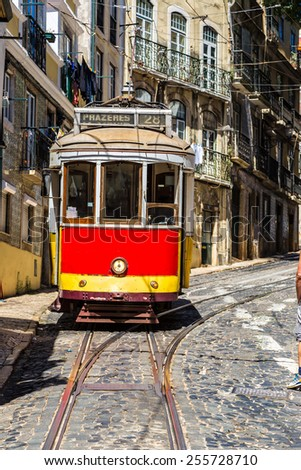 : Vintage tram in the city center of Lisbon   - stock photo