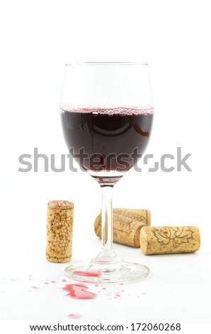vintage wine corks,red wine in wineglass on white background. - stock photo