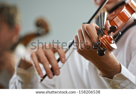 Violinist playing at the concert, close up - stock photo