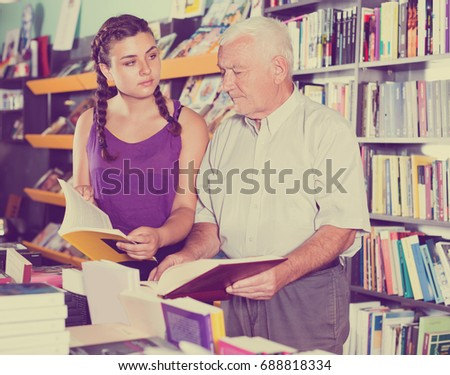 visitors are choosing books in bookstore.