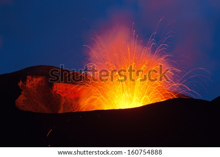Volcano exploding in the night  in Russia on the peninsula of Kamchatka - stock photo