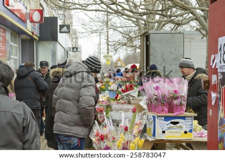 VOLGOGRAD - MARCH 8:Sale of flowers and bouquets at the street. People buy flowers in a gift on March 8. March 8, 2015 in Volgograd, Russia.