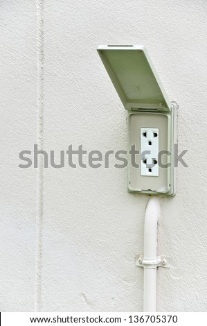 220 volt waterproof outdoor electrical power outlet at outside home wall. - stock photo