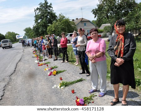 Vygoda - Ternopil - Ukraine - July 9, 2014. Residents Vygoda prepared to meet the dead body in the East of Ukraine Oleg Gulko, Ukrainian troops. His last road route passes through this village.