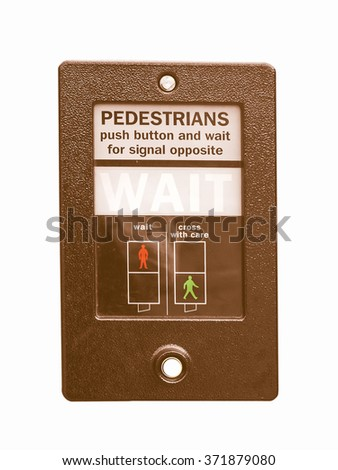 Wait sign at a traffic light for pedestrian crossing - isolated over white background vintage - stock photo