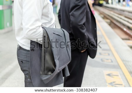 """waiting"" businessman with suit at train station"