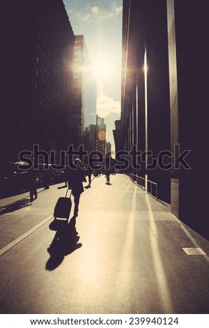 Walking on the street of New York at sunrise - stock photo