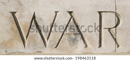 """WAR"" carved in stone at Tyne Cot War Cemetery, Flanders, Belgium.  Commemorating World War One  - stock photo"