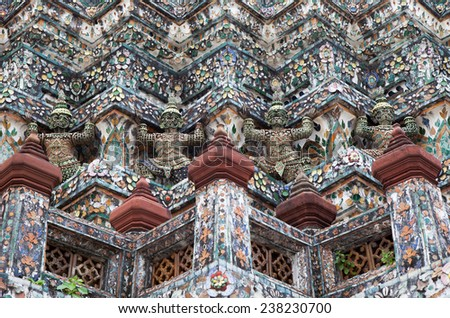 Wat Arun in Bangkok, Thailand. Demon Guardian statues decorating the Buddhist temple - stock photo