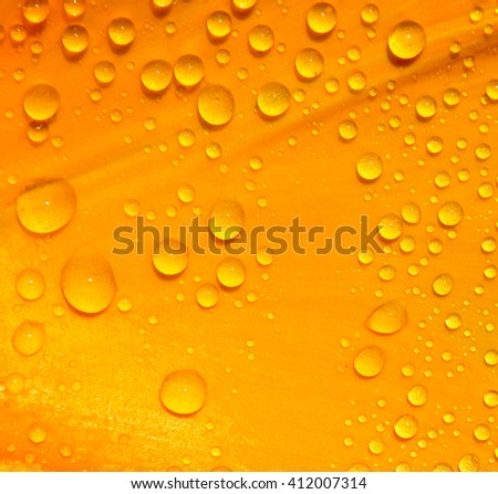 water drops on yellow. Water drops light abstract background. Beautiful fresh morning dew.Spring. Summer. Morning. - stock photo