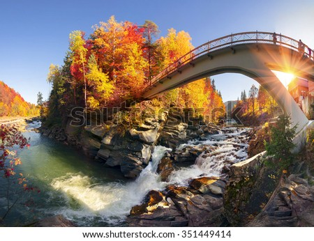 """Waterfall """"Break"""" (Probiy) on the river. Prut - one of the most full-flowing, scenic and popular waterfalls in the Carpathians. the heart of the resort Yaremche, so there is always a lot of tourists. - stock photo"""