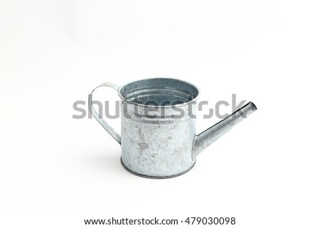 watering zinc can on white background