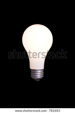 60 watt lightbulb illuminated and isolated with black background. Clipping path included.