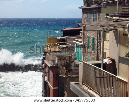 waves breaking on protective wall Riomaggiore Cinque Terre Italy Italian Riviera
