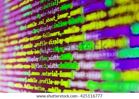 Website codes on computer monitor. Writing programming code on laptop. Programmer workplace. Programming code abstract screen of software developer. Software source code.
