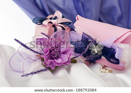 wedding favors on  a colorful fabric background - stock photo