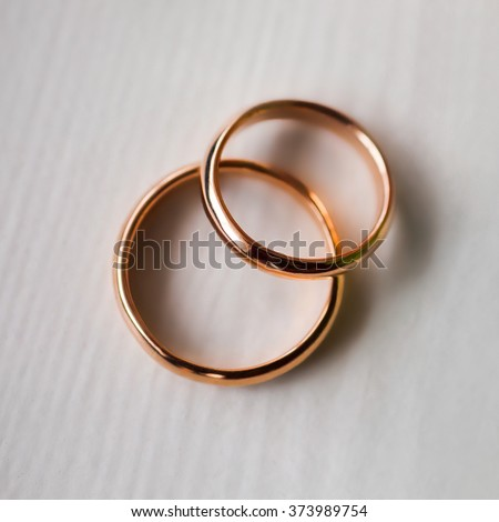 wedding rings on a white background, infinity sign of the rings,wedding bands,