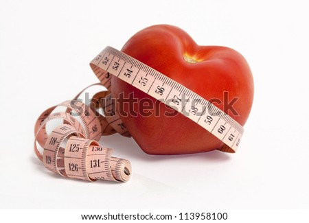 Weight and heart. Vegetables and measuring tape for a healthy lifestyle - stock photo
