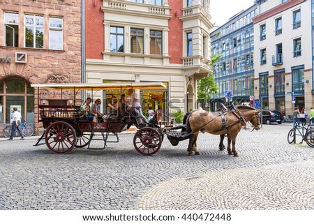 WEIMAR, GERMANY - JUL 24, 2015: Tourist horse carriage in the historic center. Weimar urban ensembles included in the World list of cultural sites under UNESCO protection