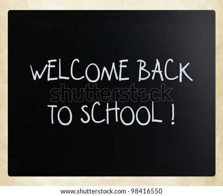 """""""Welcome back to school"""" handwritten with white chalk on a blackboard - stock photo"""