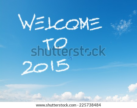 """welcome to 2015"" written in the sky with contrails left by airplane - stock photo"