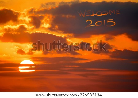 """welcome 2015"" written in the sky at sunset - stock photo"