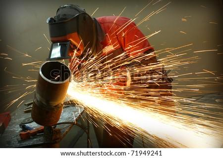 Welder works sparkle - stock photo