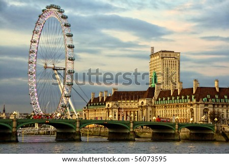Westminster Bridge and the popular tourist attraction The Merlin Entertainments London Eye - stock photo