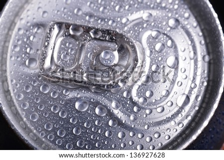 wet aluminium can with drink, close-up of top - stock photo