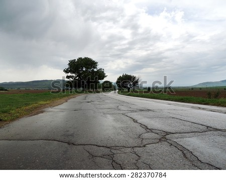 Wet Empty Country Road In A Gloomy Day         - stock photo