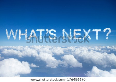 """what's next""a cloud word on sky over clouds. - stock photo"