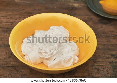 whipped cream in a yellow bowl - stock photo
