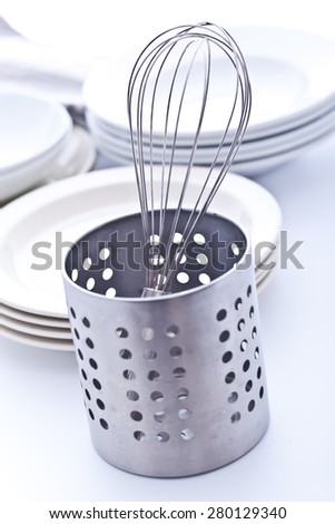 Whisk and dishes - stock photo