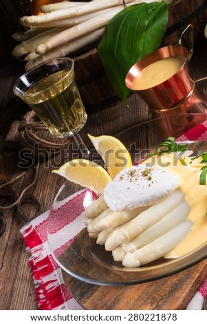 white asparagus served with a fine hollandaise sauce and Poached egg - stock photo