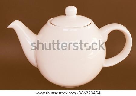 White ceramic teapot for tea vintage - stock photo