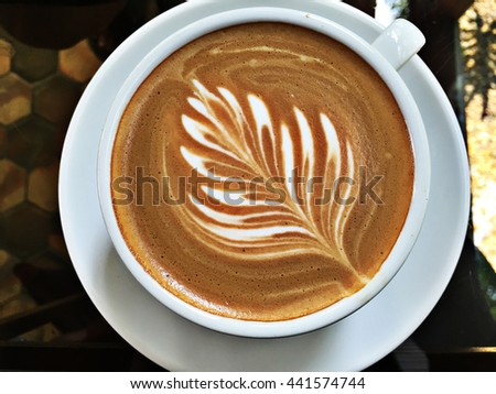 White Coffee Cup with Fresh Hot Coffee on the table. Top view. - stock photo