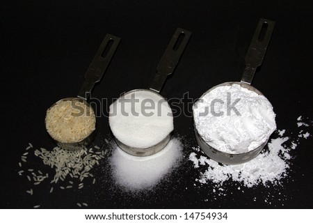 """White death"" according to most nutritionists--white rice, white sugar and white flour. - stock photo"
