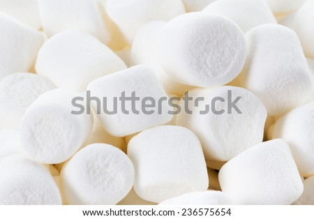 White Fluffy Round Marshmallows as a background. Sweet  Food Candy Background as poster. wallpaper, backdrop macro - stock photo