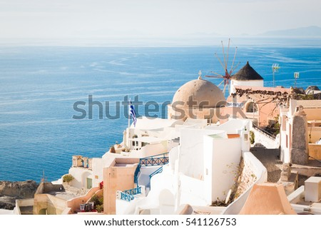 White mill and domes facing the sea photographed in Santorini