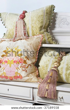 white pillows and tassel for curtains - stock photo
