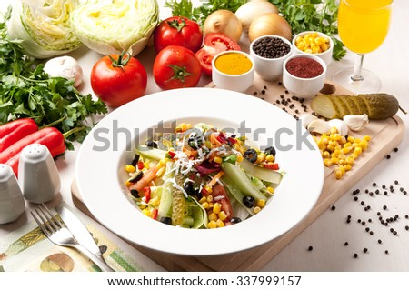 white plate salad and tomato