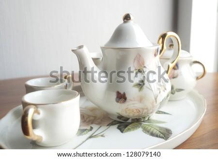 White porcelain set for tea on the table - stock photo
