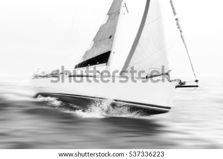 white sailboat during race at sea