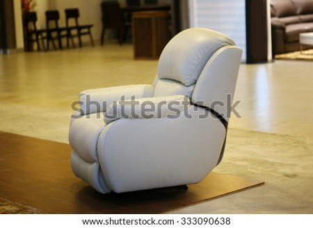 white sofa ,leather recliner armchair with massage and foot rest,  - stock photo