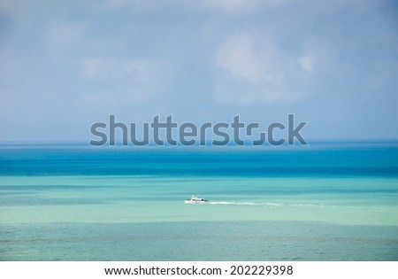 White tourist ship with French flag in the sea. Mers-les-Bains (Picardy, France) - stock photo