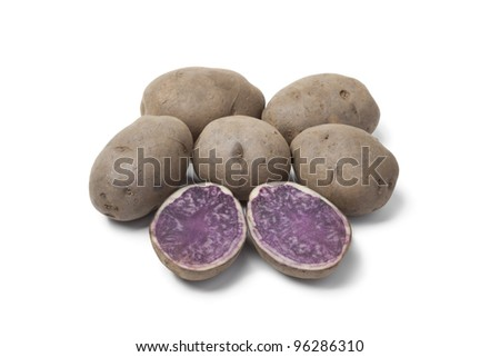 Whole and half Truffle potatoes on white background