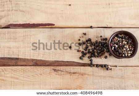 whole peppercorns on wooden spoons - stock photo