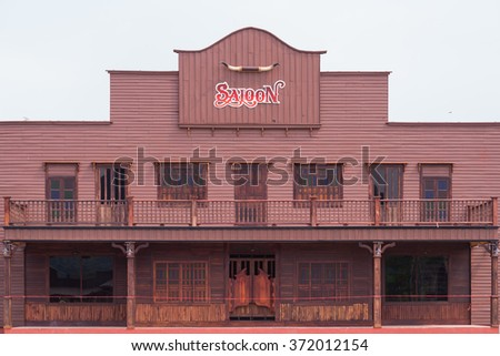 Wild West desert cowboy town with saloon - stock photo