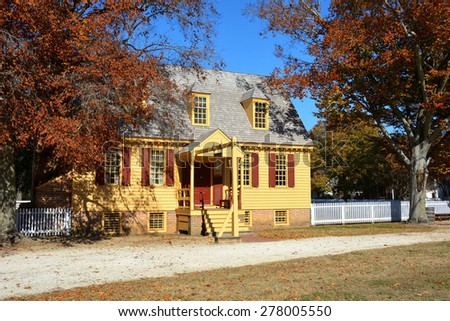 WILLIAMSBURG, VIRGINIA - NOVEMBER 19 2014: The School House in Colonial Williamsburg. The restored town is a living-history museum and a major attraction for tourists and field trips.    - stock photo